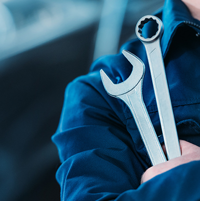 person holding wrenches