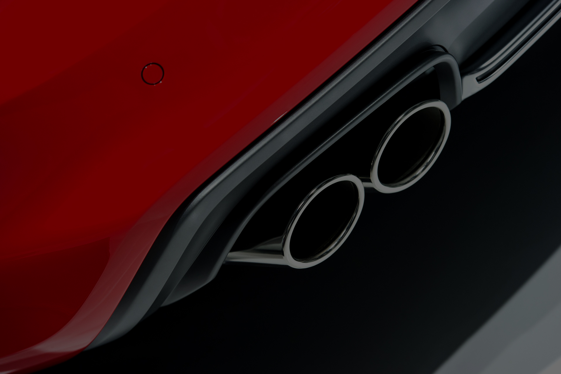 red car part with exhaust